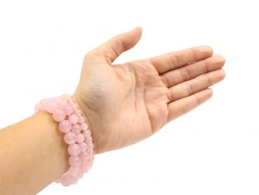 Rose quartz bracelets hand photo - Crystal Dreams