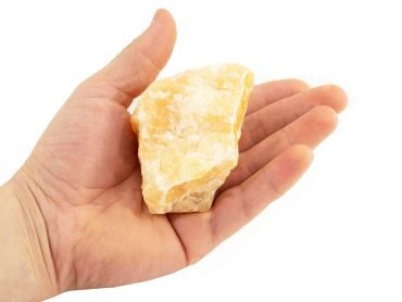 Rough Orange Calcite (hand) - Crystal Dreams